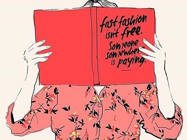 A woman reading a book about fast fashion wearing a flowered blouse
